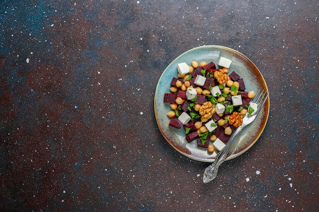 Delicious beet salad with feta cheese or goat cheese and chickpeas,top view
