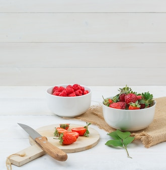 Delicious berries on the wooden table