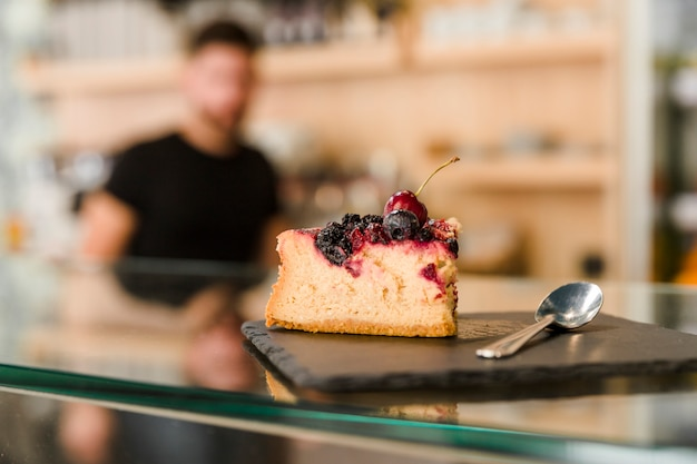 Delicious berry pastry on glass counter