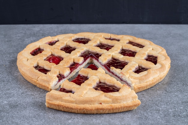 Delicious berry pie on marble surface