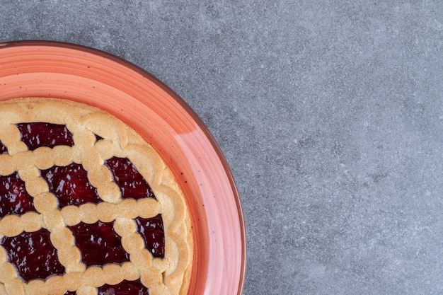 Delicious berry pie on red plate