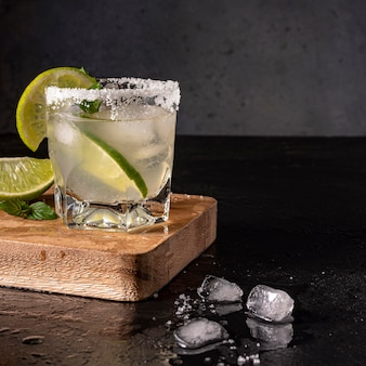 Delicious beverage with lime and ice