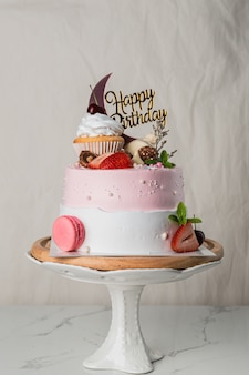 Delicious birthday cake with happy birthday tag on light background