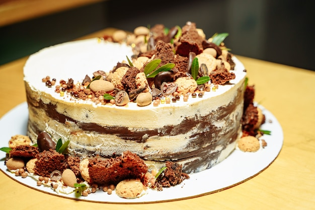 Delicious birthday cake with nuts and chocolate.
