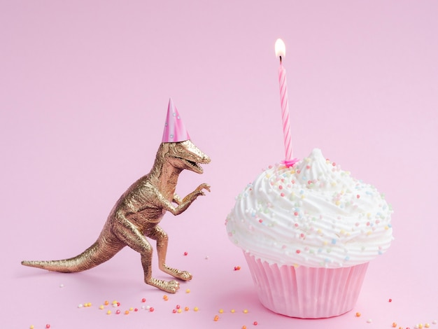 Delicious birthday muffin and dinosaur