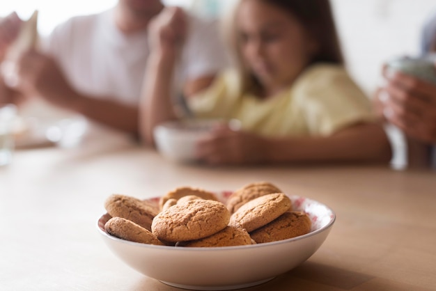 Delicious biscuits in bowl on table