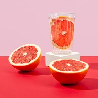 Delicious blood orange half in glass