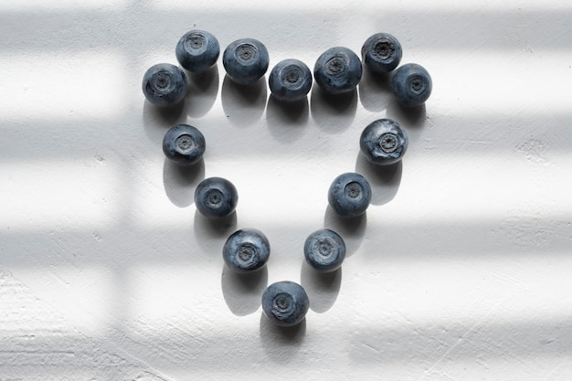 Delicious blueberries formed into a heart shape.