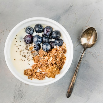 Delicious breakfast bowl with granola and blueberries