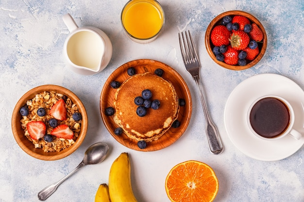 Delicious breakfast on a light table. top view, copy space.