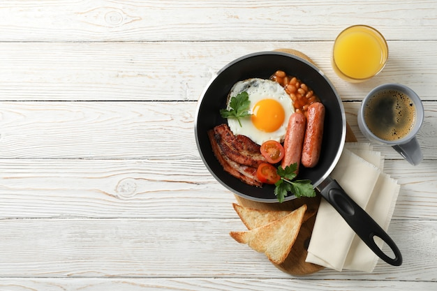 Delicious breakfast or lunch with fried eggs on wooden table, top view