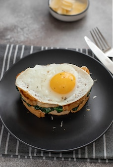 Delicious breakfast sandwich with fried egg
