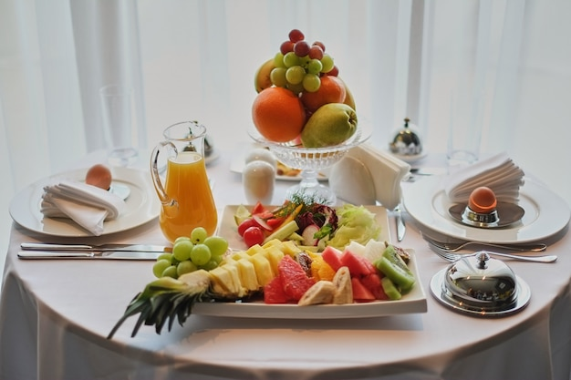 Delicious breakfast served for two at the hotel a white background.