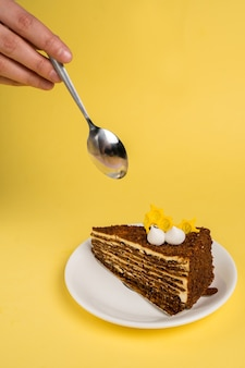 Delicious breakfast with the cake and black tea on yelow background top view copy space