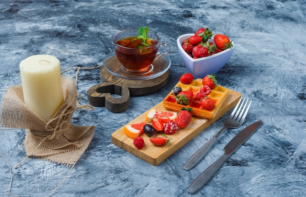 Delicious breakfast with waffle and fruits