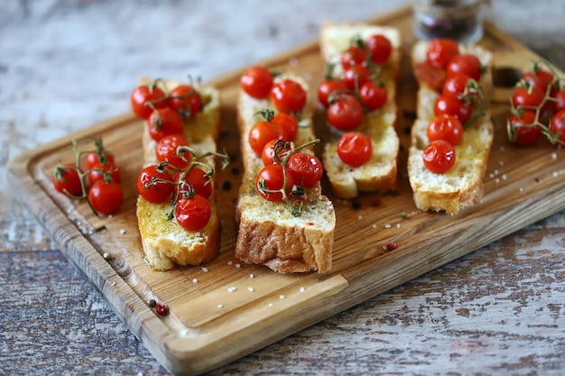 Delicious bruschetta with cherry tomatoes and olive oil