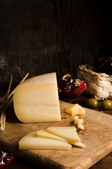 Delicious buffet with cheese on wooden board