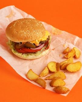 Delicious burger on an orange.