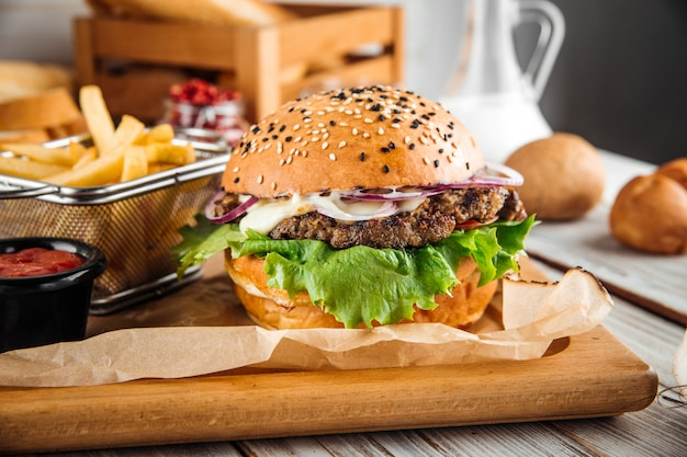 Delicious burger with lamb patty and vegetables