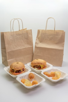 Delicious burgers with beef patty and lettuce leaves and cheese balls, fast food delivery concept