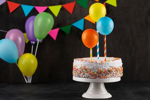 Delicious cake and party decorations arrangement