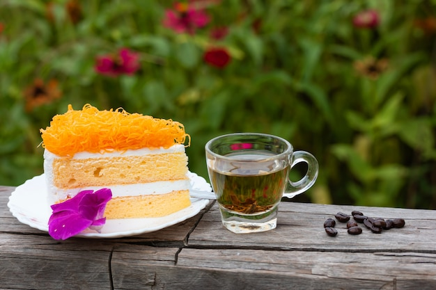 Delicious cake sprinkled with sweets with pea flowers