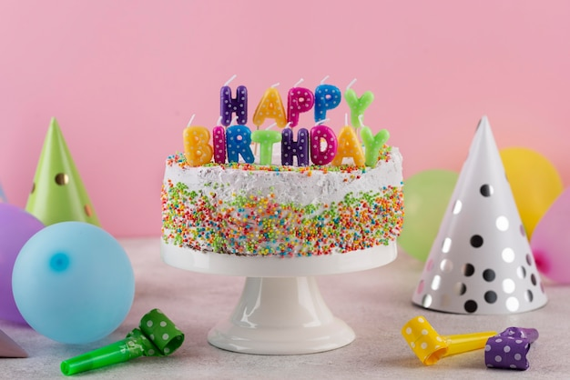 Delicious cake with birthday items