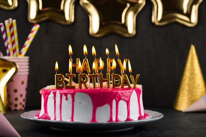 Delicious cake with candles arrangement