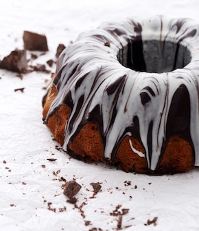 Delicious cake with chocolate on white