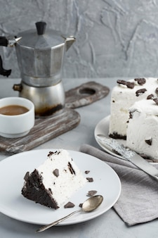 Delicious cake with coffee cup