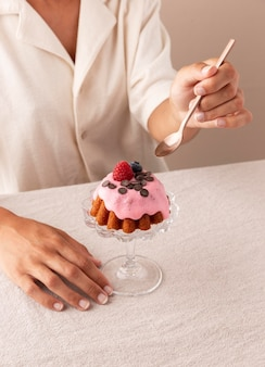 Delicious cake with forest fruits arrangement