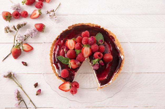 Delicious cake with forest fruits composition