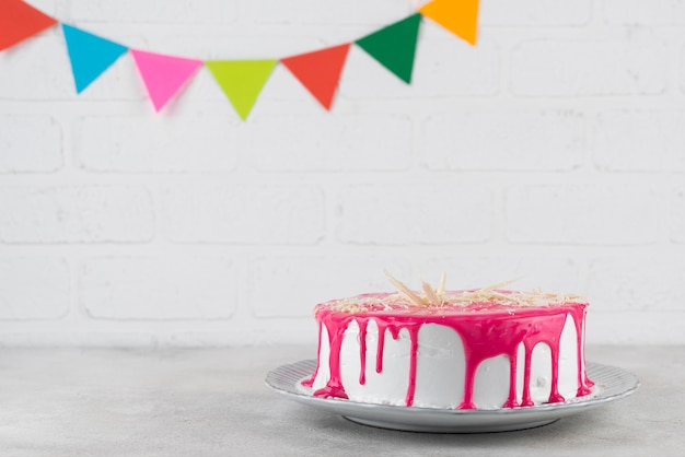 Delicious cake with glaze on plate