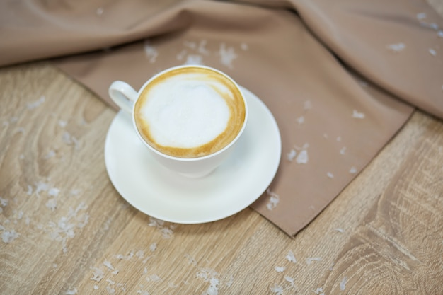 Delicious cappuccino coffee cup on wooden table
