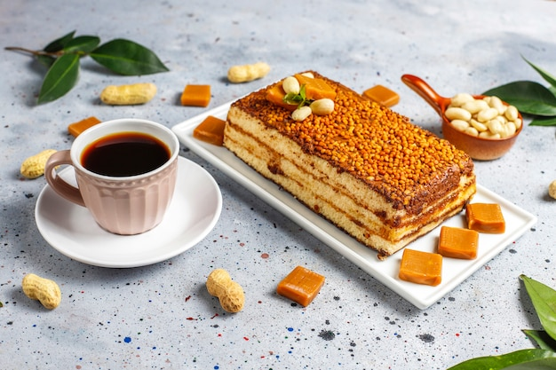 Delicious caramel and peanut cake with peanuts and caramel candies,top view