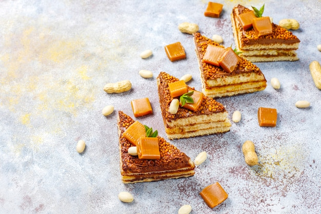 Delicious caramel and peanut cake with peanuts and caramel candies
