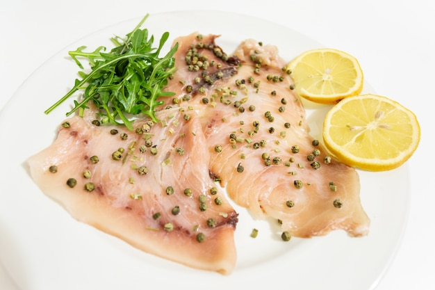 A delicious carpaccio of fresh swordfish, seasoned with extra virgin olive oil, chives and a few drops of lemon juice