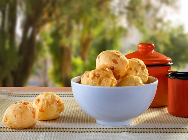 Delicious cheese breads in a bowl on the table