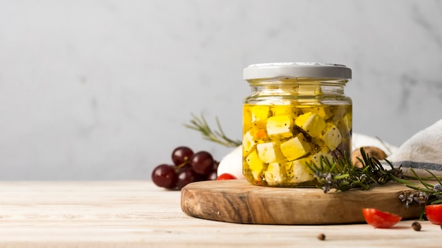 Delicious cheese in jar with copy space