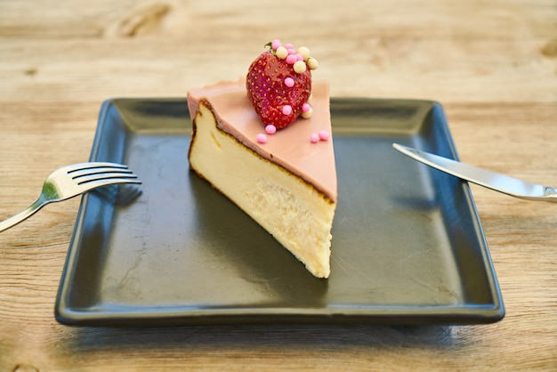 Delicious cheesecake on the wooden table