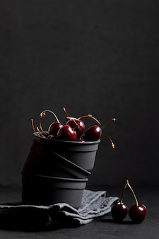Delicious cherries in bowl front view