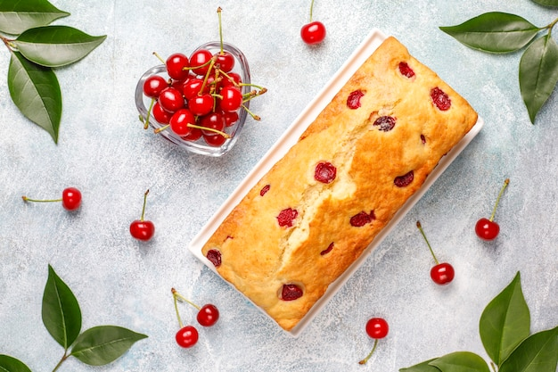 Delicious cherry cake with fresh cherries, top view
