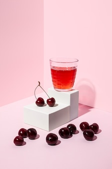 Delicious cherry juice with pink background