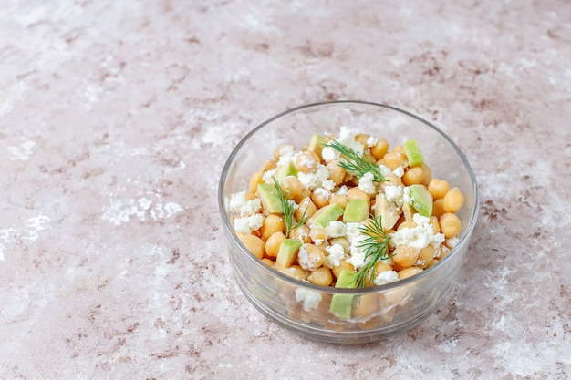 Delicious chickpea salad with avocado and feta cheese,top view
