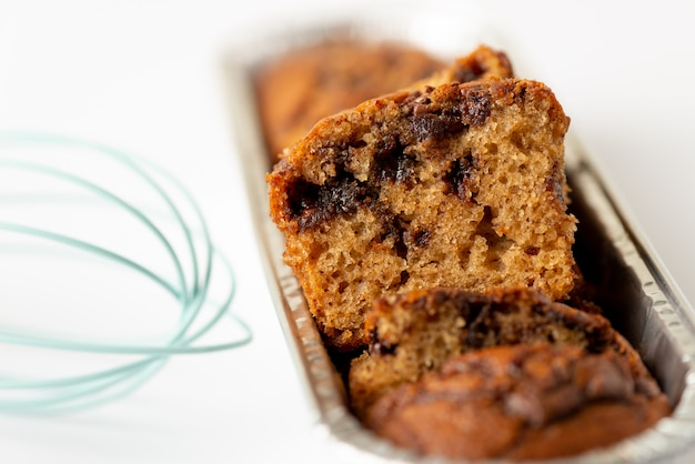 Delicious chocolate banana cake on white background. selective focus