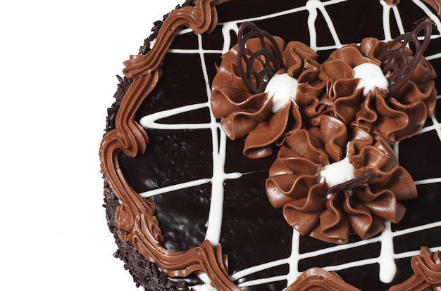 Delicious chocolate cake isolated on white background closeup