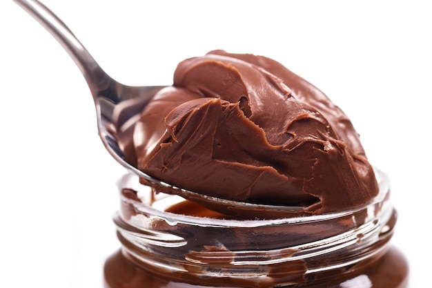 Delicious chocolate cream on a spoon
