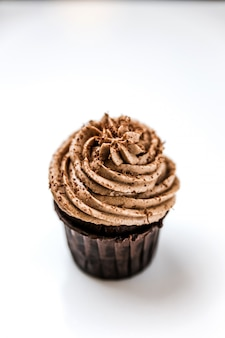 A delicious chocolate cupcake with cream