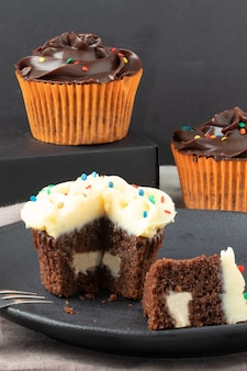 Delicious chocolate cupcakes stuffed with white chocolate cream.