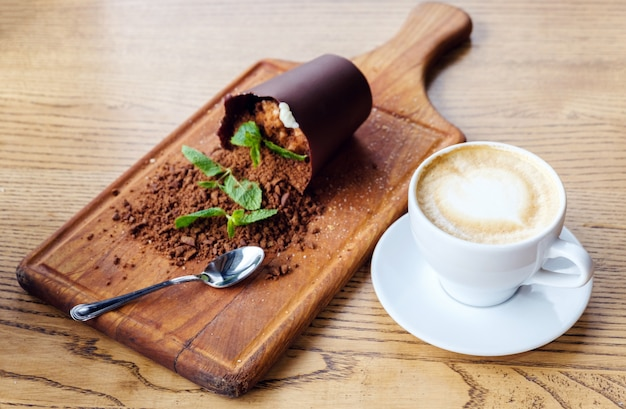 Delicious chocolate dessert with cappuccino